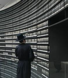 A Jewish man views the room of names at Yad Vashem.