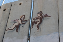 One of Banksy's newer works on the wall depicts two angels