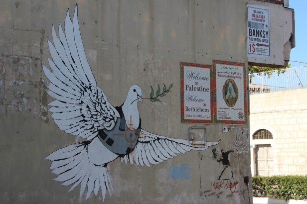 Banksy: A dove carries an olive branch in a bullet-proof vest with a target on its chest.