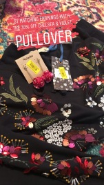 Chelsea and Violet sweater $100 for $30, earrings $7