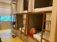Private bed layouts with lights and charging ports inside each cubby.